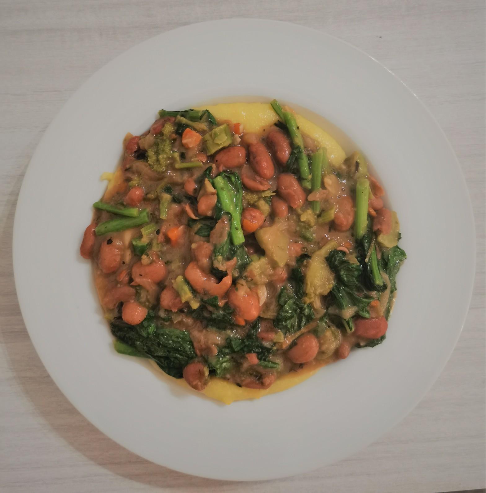 Polenta topped with borlotti beans stewed with cime di rapa.
